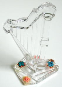 Leo Jean's Starlike© tiny paper sculptures at base of crystal harp.