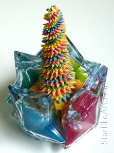 Leo Jean's Starlike© paper sculpture mounted inside 4 glass stars