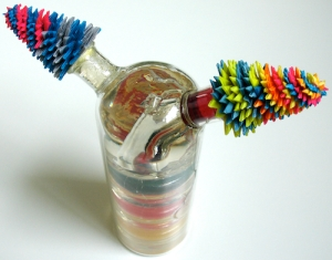 Leo Jean's Starlike© Opposites; paper sculptures atop bottle with layered color resin interior