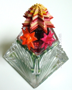 Leo Jean's Starlike© paper sculpture mounted on crystal pyramid