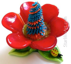 Leo Jean's Starlike© paper sculpture mounted on glass flower
