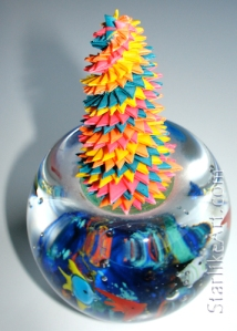 Leo Jean's Starlike© paper sculpture on glass fishbowl paperweight