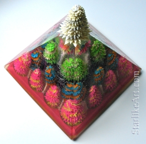 Leo Jean's Starlike© paper sculptures: 24 inside a resin pyramid topped by glowing Starlike©