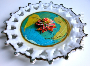 Leo Jean's Starlike© paper sculpture on ceramic plate with world map