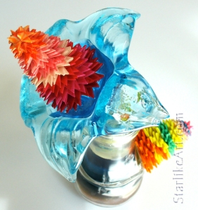 Leo Jean's Starlike© paper sculptures mounted on turquoise flower glass base