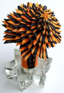 Leo Jean's Starlike© spiralling paper sculpture on glass base