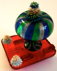 Leo Jean's Starlike© paper sculptures atop colorful glass on resin base