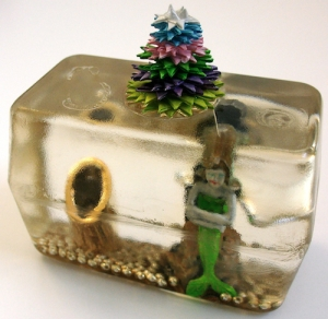 Leo Jean's Starlike© paper sculpture atop mermaid figurine imbedded in resin