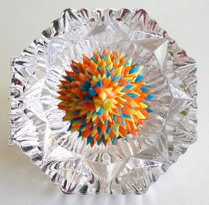 Leo Jean's Starlike© paper sculpture atop cut crystal diamond