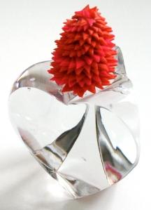 Leo Jean's Starlike© Art sculpture atop crystal triangular heart