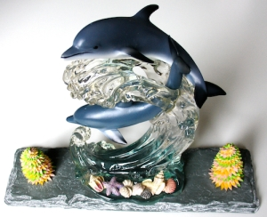 Leo Jean's Starlike© paper sculpture mounted on slate with porcelain and resin dolphin figurine