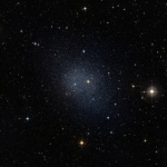 This dwarf spheroidal galaxy in the constellation Fornax is a satellite of our Milky Way and is one of 10 used in Fermi's dark matter search. The motions of the galaxy's stars indicate that it is embedded in a massive halo of matter that cannot be seen. Image credit: ESO/Digital Sky Survey 2