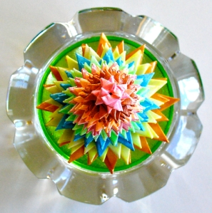 Leo Jean's Starlike© paper sculpture atop crystal.